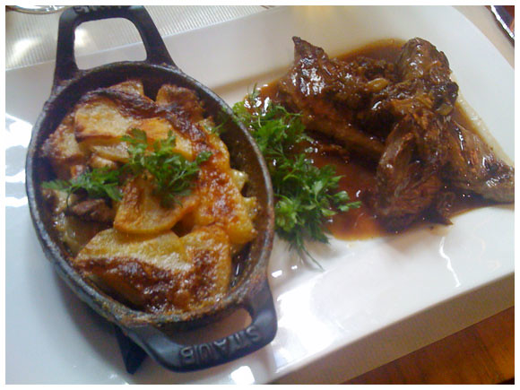 Veal hanger steak with a side of gratin dauphinois at La Table du 9 located in Geneva's Old Town