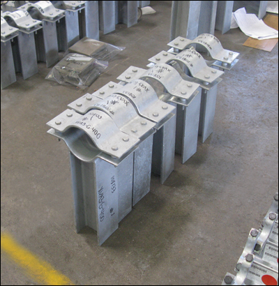 Custom Designed Pipe Clamp-Guides for an LNG facility