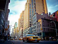 27th and 5th Ave, New York (Josh Liba) Tags: city nyc newyorkcity sunset sky ny newyork streets color buildings golden vanishingpoint colorful cityscape traffic cab taxi low samsung wideangle josh ave fifthavenue typical cabs 5th 27th liba ex1 tl500 joshlibacom