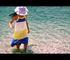 flower in the sea (Fayo0rah) Tags: blue sea summer baby flower water girl canon happy walk rahaf fajer 50d