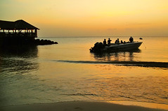 Cooling out in Ste Lucia... (jendayee) Tags: sunset red sea orange beach yellow boat caribbean soe stlucia westindies abigfave flickraward platinumheartaward sunsetmania ashotadayorso dazzlingshots thebestofday gnneniyisi gnneniyisithebestofday flickraward5 blinkagain bestofblinkwinners