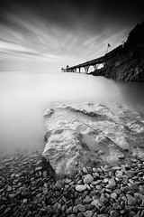 Little rocks, big rock, pier (le-spikey) Tags: sea white black lines rock silver pier big high nikon flag tide hard somerset pebbles tokina lee pro fx grad f28 fluttering foreground clevedon stopper 1116 06nd d300s