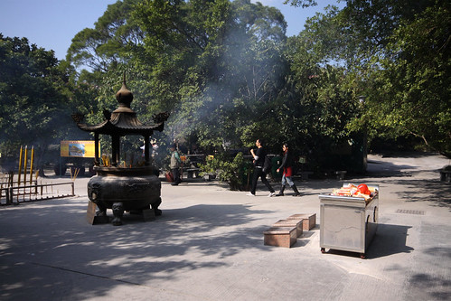 Burning incense outside the temple