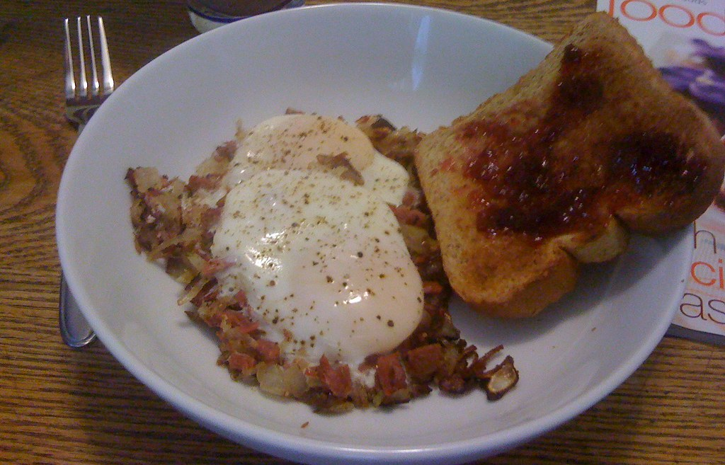 Corned Beef Hash with cooked egg on top.