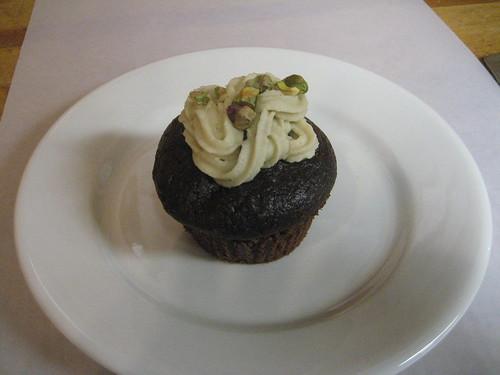 cupcake with pistachio cream icing