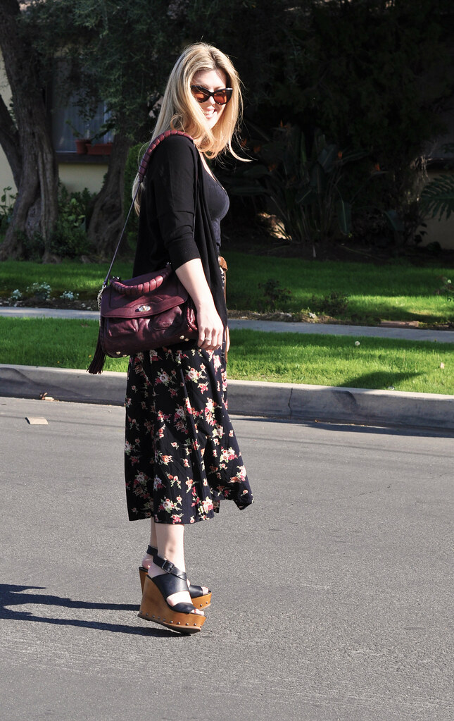 long floral print skirt and cat eye sunglasses
