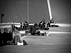 Opera goers (Tadgh  Maoildearg) Tags: life camera sky people urban bw white black blur reflection leave glass lines sunglasses bicycle oslo norway concrete evening living photo spring opera noir foto folk steel couples social olympus diagonal human shore paving accessories bags scarves vignette blanc enjoyment slop vr vitt svart sunworship behaviour e510 bn dubh uptheroad timruttledge timelmarinero