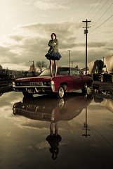 alley rae & the impala (metakephoto) Tags: woman reflection clouds oregon portland puddle telephone pole chevy pdx impala tutu marionette metakephoto jeffmawer