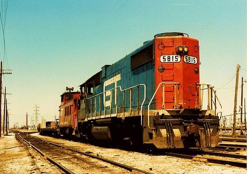 Grand Trunk Western locomotive, caboose and train of flatcars at Elsdon Yard. Chicago Illinois USA. October 1983. by Eddie from Chicago