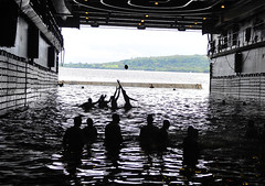 Sailors play football during a swim call in the well deck of USS Cleveland (LPD 7). (Official U.S. Navy Imagery) Tags: football navy sailor usnavy vanuatu espiritusanto amphibioustransportdockship welldeck swimcall ussclevelandlpd7 pacificpartnership2011
