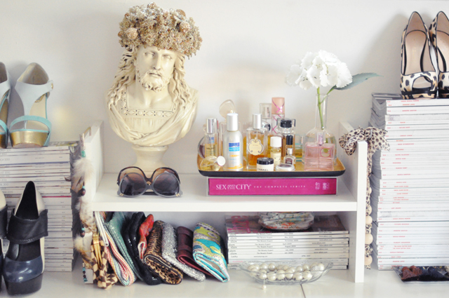 shoes+clutches+perfumes+sunglasses+jesus bust+magazines+dressing room accents