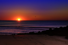 Amazing Grace (Moniza*) Tags: ocean sunset sea sky sun seascape beach nature water silhouette clouds sunrise landscape dawn newjersey twilight sand nikon rocks waves dusk nj rocky explore shore jersey bluehour jerseyshore oceangrove d90 explored moniza