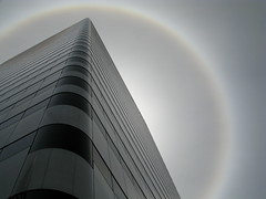 Modern Pyramid w/ halo (Dialed-in!) Tags: above city urban building tower monochrome oregon skyscraper portland vanishingpoint haze downtown natural grandmother or stripes gray frombelow monochromatic ring lookingup parhelion pdx grayscale left sundog bigmomma pacwestcenter matchpointwinner dialedin thechallengefactory mpt204