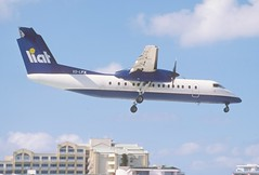 283cc LIAT DHC-8-311 Dash 8; V2-LFX@SXM;05.03.2004 (Aero Icarus) Tags: slidescan plane avion aircraft flugzeug princessjulianainternationalairport mahobeach saintmartin sxm