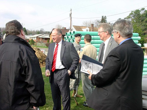 Congressman Mark Critz, center, Col. William H. Graham, District Engineer, US Army Corps of Engineers, back, and Thomas P. Williams, USDA Rural Development State Director, right, talk with local residents at the Washington Township Phase II Sewer Project Groundbreaking on March 21, 2011.