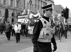 Hull Protest March (Matthew Kelly) Tags: street city school blackandwhite white black art college canon poster eos design march matthew flag centre banner streetphotography documentary police matthewkelly speaker kelly gmb usm hull job protests ef 1740mm cuts officer placard upon steward kinston policeofficer kingstonuponhull pcso f40l 400d canoneos400d hsad canonef1740mmf40lusm jobcuts hullschoolofartanddesign