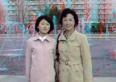 Mother and daughter, Pyongyang, North Korea - 3D (Eric Lafforgue) Tags: water smile togetherness 3d women war asia eau capital joy anaglyph korea communism maternity stereo together asie capitale coree ensemble sourire twopeople bonheur joie communisme femmes northkorea motheranddaughter hapiness pyongyang dprk maternite coreadelnorte waterjets nordkorea waistup moterhood  0235 jetsdeau mereetfille   coreadelnord  coreedunord  insidenorthkorea  rpdc  kimjongun coreiadonorte  cadragealataille audessusdelataille