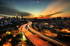 Kuala Lumpur at night (naza.carraro) Tags: city longexposure travel bridge blue light sunset sky urban building tower tourism skyline architecture modern night skyscraper landscape star town office high construction nikon highway asia downtown citysca