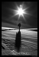 Into The Light (AlpineEdge) Tags: winter shadow blackandwhite bw sun snow man mountains cold ice weather skiing hiking sunny hike alpine flare snowshoeing conrast sunspots