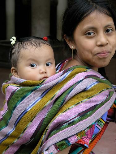 Carrying her little sister - Cargando a la hermanita; Zunil, Quetzaltenango, Guatemala by Lon&Queta