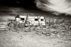 Forlorn Vacations (Lenzair) Tags: california sea white black abandoned sepia trailer camper colouring olde tyme salton saltonbeach