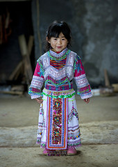 Hmong Girl In Traditional Dress, Sapa, Vietnam (Eric Lafforgue) Tags: people girl smile childhood smiling vertical female youth standing person one kid asia interior fulllength vietnam viet innocence asie humanbeing sapa oneperson traditionaldress colorphoto vietname  wietnam northernvietnam lookingatcamera traditionalclothes reddao reddzao daopeople    vietnam7623