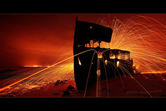 Steel works (Garry - www.visionandimagination.com) Tags: longexposure light red orange beach night port fire rust iron nocturnal steel spin digitalart australia brisbane mining sparkle da lp qld redcliffe furnace wreck 2am sparks ore corrosion smelter steelwool gayundah colorphotoaward hmqsgayundah nightphotographylightpainting