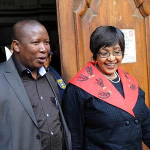 African National Congress Youth League leader Julius Malema and ANC MP Winnie Mandela leaving the Guateng court where Malema is being accused of increasing racial tensions by singing revolutionary songs from the days of the armed struggle in South Africa. by Pan-African News Wire File Photos