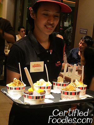 Kenny Rogers staff bringing in cups of Frozen Yoghurt with different toppings - CertifiedFoodies.com