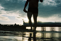 low down in the morning (lomokev) Tags: sea cloud reflection beach silhouette pier brighton low moring brightonpier palacepier deletetag roll:name=090909nikonosvvc file:name=090909nikonosvvc37