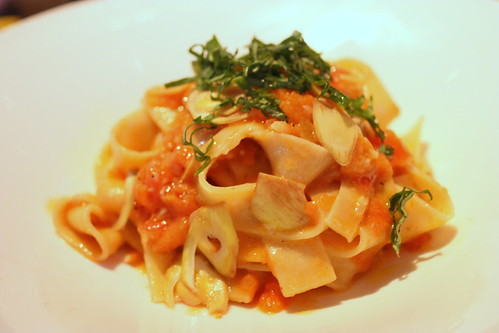 handmade papperdelle with tomatoes, artichokes, and fresh basil
