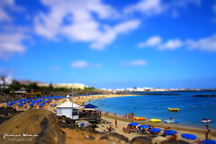 Blue days. (Yavanna Warman {off}) Tags: ocean blue sea summer sky beach water azul clouds umbrella canon eos mar shift stall lanzarote playa canarias sunshade cielo nubes verano kiosk tilt playablanca chiringuito tiltshift sombrillas hamacas tumbonas yavanna 1000d yavannawarman