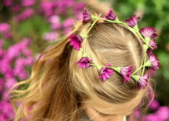 Daisy Chain (Bunches and Bits {Karina}) Tags: flowers light girl hair fun golden spring lashes purple bokeh outdoor twirl gazania