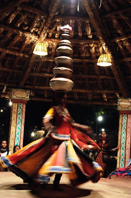 Folk dancer with pots on her head