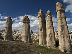 Fairy chimneys in Cappadocia, Turkey (Pavel Chonya) Tags: travel mountain mountains tourism nature landscape rocks asia view pillar turkish cappadocia anatolia greme excavation fairychimney capadocia fairychimneys