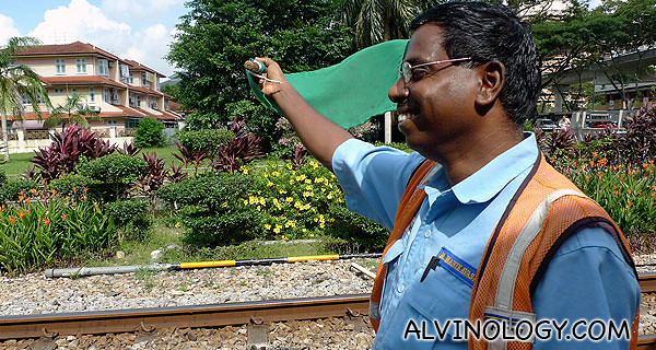 Mr Manikavasam at work with his flag