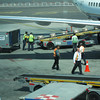 Loading (nateOne) Tags: orange green tarmac airplane iso100 airport gate ground crew vest schnivic freight loading mex 225mm 6225mm 1250secatf49 canonpowershots95 focusdistance6440m