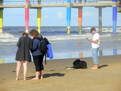 Enjoying the Beach (Quetzalcoatl002) Tags: beach people phones distraction scheveningen seaside mars pier