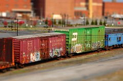 Freight train graffiti tilt-shift (Rob Swatski) Tags: street railroad blue red streetart green art car wisconsin yard train bench toy graffiti miniature model nikon paint grafitti little pennsylvania tag graf small central tracks fake shift rail railway trains mini bn caboose pa railcar tiny spraypaint boxcar graff tilt effect railyard railways railfan freight freighttrain freights rollingstock tiltshift faketiltshift benching freighttraingraffiti swatski tiltshiftmaker
