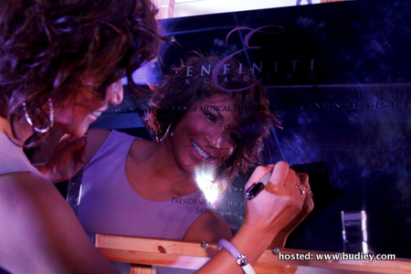 Tiara signing the official plaque