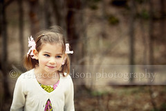 Portrait of a girl in forest (Rebecca812) Tags: park family portrait cute girl beautiful childhood smiling forest happy sweater kid child play dress sweet innocent daughter copyspace pigtails cardigan naturepreserve mischevious hairribbon canon5dmarkii rebecca812 heritage2011