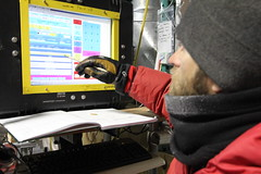 John Fegyversi enters the ice core logging information into a computer at WAIS Divide