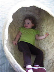 Speck lying flat in a giant dinosaur egg at the Philadelphia zoo