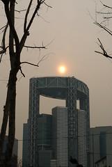 Skyscraper from the future (cheesemonster) Tags: sky orange sun building tower vertical skyscraper smog glow bright bladerunner jongno futuristic smoggy core bellstreet bladerunneresque coredusud jongnotower