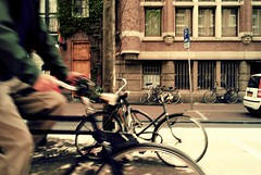 Dutch cycling (tychay) Tags: amsterdam bicycle action travelphotography curvesadjustment levelsadjustment leicam8 exposureadjustment rawfinetuningadjustment straightenadjustment colormonochromeadjustment zeissbiogon2825zm edgesharpenadjustment sepiatoneadjustment