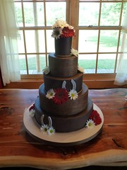 western wedding cake (RebeccaSutterby) Tags: horseshoes westernweddingcake cowboycake redgerberas tooledleathercake
