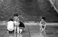 Girls | Boy (Skies of Bitan ) Tags: blackandwhite playing film water fountain analog children taiwan taipei analogue  rodinal  praktica   bitan monocrome moviefilm blancetnoir taipeicounty prakticamtl5b   eastman5222 helios442  eastmandoublex  commiecamera newtaipei   epsonperfectionv600