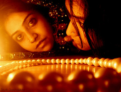 Is this me or is this you? (Stuti ~) Tags: wood light portrait india love girl self fire mirror big eyes candle floor pearls flame string mumbai