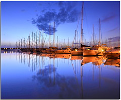 Evening mirror (Nespyxel) Tags: alberi port reflections boats mirror evening harbour barche calm porto bluehour riflessi sera specchio crepuscolo reflexes civitavecchia orablu simmetrie simmetries nespyxel stefanoscarselli magicalskies saariysqualitypictures
