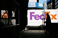 downtown deliverables (ho_hokus) Tags: nyc newyorkcity reflection silhouette truck downtown scaffolding shadows manhattan streetphotography pedestrian 35mmfilm delivery gt fedex minox minox35gt filmphotographypodcast ny2011